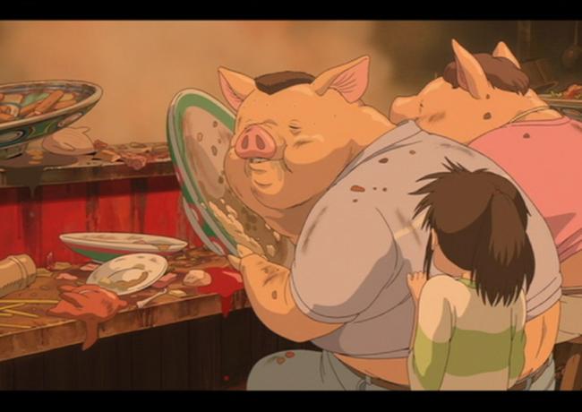 """I genitori di Chihiro trasformati in maiali. Fotogramma de: """"La città incantata"""""""